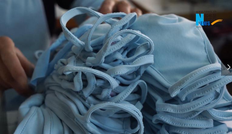 vlog:新華網探訪口罩生産流水線